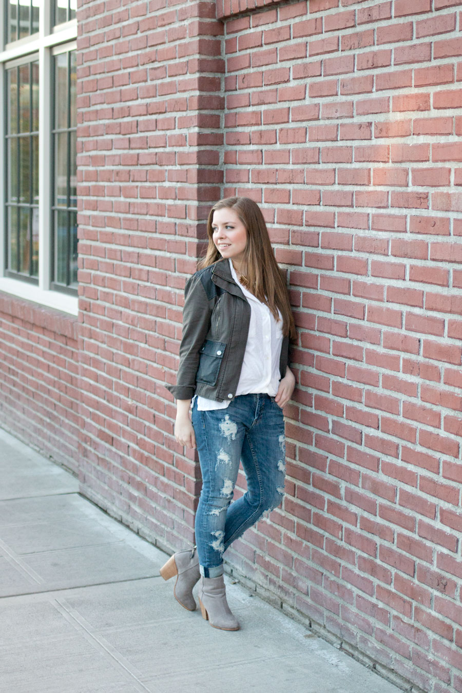 How to Wear Distressed Jeans: Military Jacket, White Collared Shirt, Distressed Skinny Jeans, & Gray Booties Outfit / hellorigby seattle fashion blog