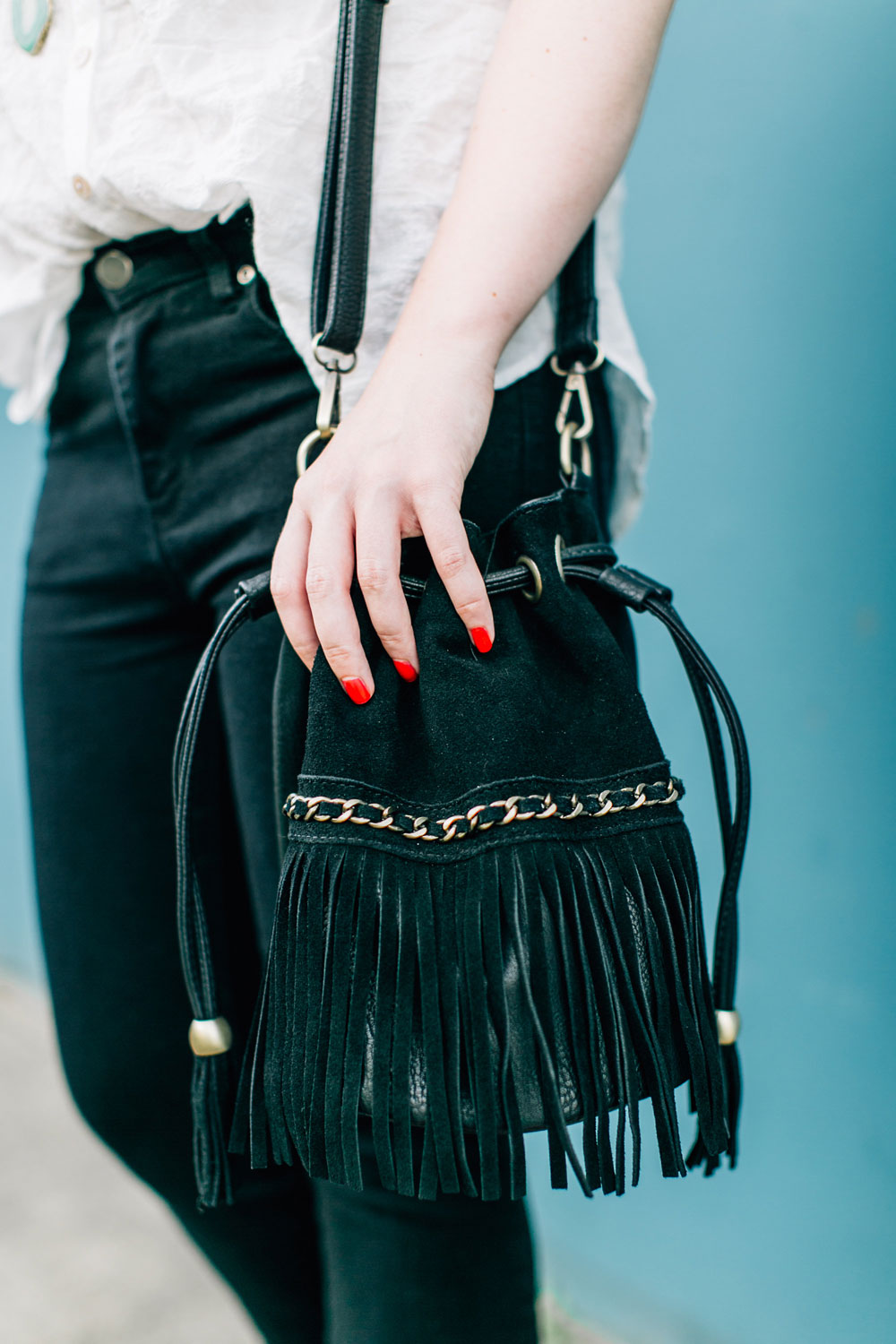Flare Jeans Outfit with Fringe Bucket Bag // hellorigby seattle fashion blog